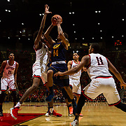 09 December 2017:  The San Diego State men's basketball team hosts the California Golden Bears Saturday afternoon. San Diego State Aztecs forward Jalen McDaniels (5) defends California Golden Bears guard Don Coleman (14) as he attempts a shot in the first half. The Aztecs trail 39-34 at halftime.<br /> www.sdsuaztecphotos.com