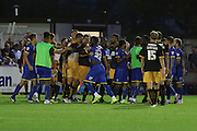 Liam Hughes lets things boil over at the half time whistle during the Sky Bet League 2 match between AFC Wimbledon and Cambridge United at the Cherry Red Records Stadium, Kingston, England on 18 August 2015. Photo by Stuart Butcher.