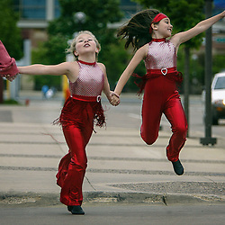 An enthusiastic Ally Badger,7, left, and Lauren Burke,7, danced their way through the walkway at Civic Center Drive Tuesday May 15, 2007.  The little performers are with Janet Lang Studio and Lauren's mother Kelley Shook were picking them up after dress rehearsal at the Mayo Civic Center.  (Christina Paolucci, Post-Bulletin)