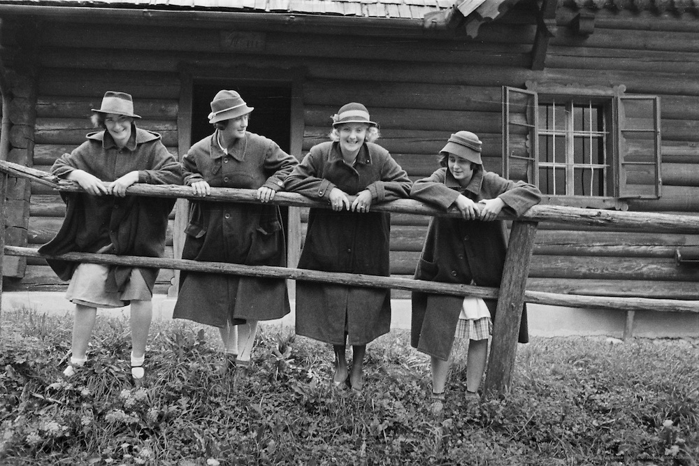 Women Leaning on Wooden  Railing, Hopfing, Austria, circa 1933