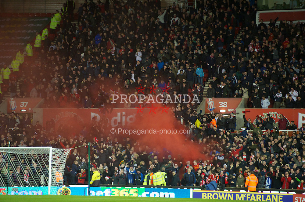 STOKE-ON-TRENT, ENGLAND - Boxing Day Wednesday, December 26, 2012: Liverpool supporters set off a red smoke bomb as they celebrate Luis Alberto Suarez Diaz winning a penalty against Stoke City during the Premiership match at the Britannia Stadium. (Pic by David Rawcliffe/Propaganda)