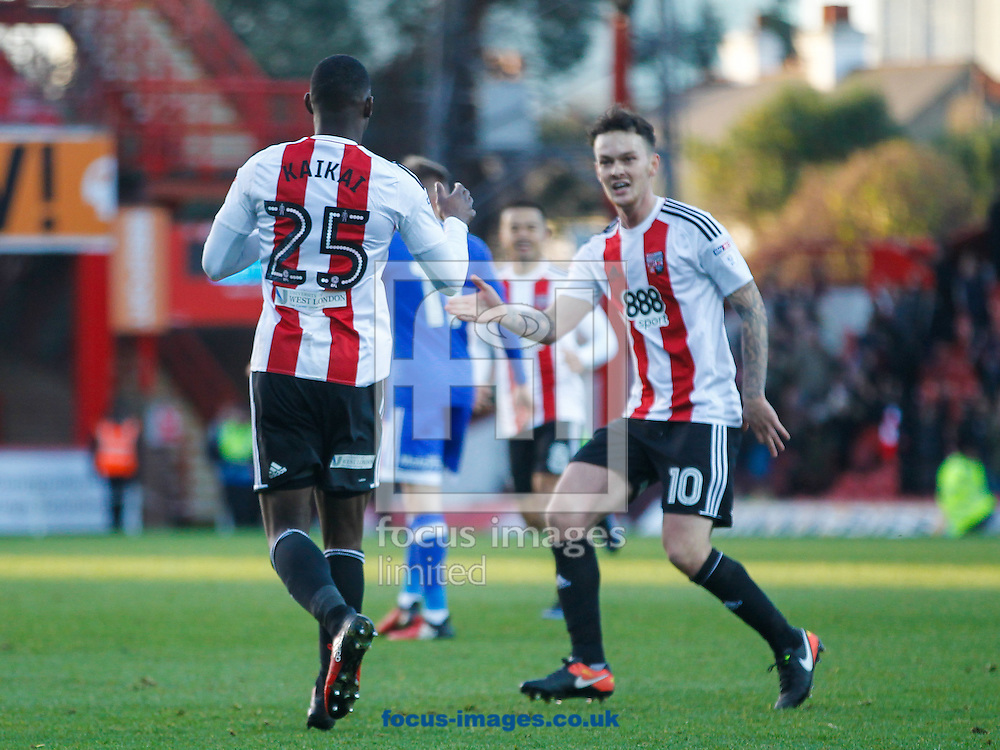 Sullay Kaikai of Brentford celebrates scoring his second goal with Josh McEachran of Brentford during the Sky Bet Championship match between Brentford and Cardiff City at Griffin Park, London<br /> Picture by Mark D Fuller/Focus Images Ltd +44 7774 216216<br /> 26/12/2016