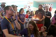 Eli Flippen, left, wipes away tears as Cameron Kelly-Johnson, right, brings in a cake to celebrate memories of Pegasus Records on Saturday, April 16, 2016 in Florence, Ala. Saturday, which was Record Store Day, was the last day the store was open for business. Eli and his father ran the store for over 30 years.