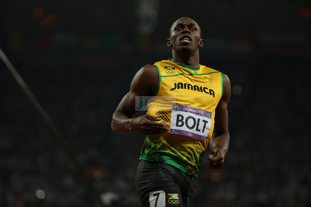 Usain Bolt of Jamaica celebrates after crossing the finish line to win the gold medal during the 200m final during track and field at the Olympic Stadium during day 13 of the London Olympic Games in London, England, United Kingdom on August 3, 2012..(Jed Jacobsohn/for The New York Times)..