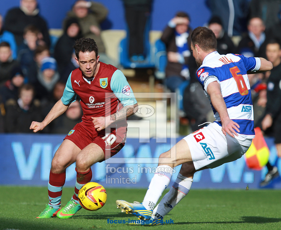 Picture by John Rainford/Focus Images Ltd +44 7506 538356<br /> 01/02/2014<br /> Clint Hill of Queens Park Rangers and Danny Ings of Burnley during the Sky Bet Championship match at the Loftus Road Stadium, London.
