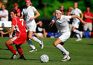 6 MAY 2010 -- FRONTENAC, Mo. -- St. Joseph Academy soccer player Abbey Stock (2) pushes the ball past Incarnate Word Academy's Molly Costello (7) during a match between the two St. Louis soccer powers at St. Joseph's in Frontenac, Mo. Thursday, May 6, 2010. Photo © copyright 2010 by Sid Hastings.