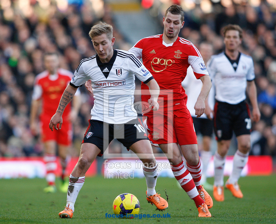 Picture by Andrew Tobin/Focus Images Ltd +44 7710 761829<br /> 01/02/2014<br />   new signing Lewis Holtby of Fulham is challenged by Morgan Schneiderlin of Southampton  during the Barclays Premier League match at Craven Cottage, London.
