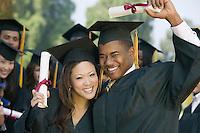 Happy Graduates with Diplomas
