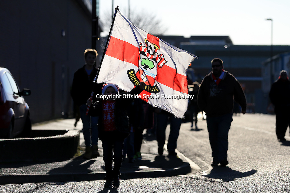 28th December 2014 - Barclays Premier League - Southampton v Chelsea - A young fan arriving with the sun shining through his flag - Photo: Simon Stacpoole / Offside.