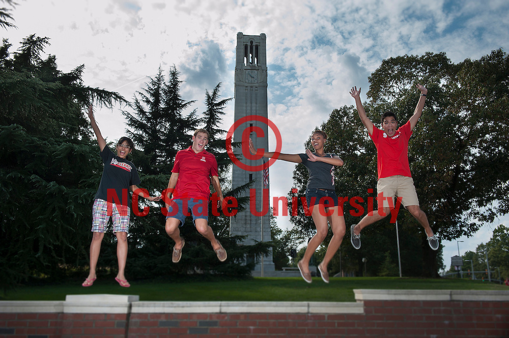 Students jump for joy at the Belltower. Photo by Marc Hall