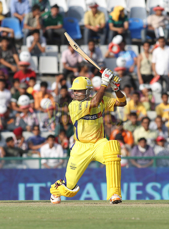 Suraj Randiv of the Chennai Super Kings square drives a delivery towards the boundary during match 9 of the Indian Premier League ( IPL ) Season 4 between the Kings XI Punjab and the Chennai Super Kings held at the PCA stadium in Mohali, Chandigarh, India on the 13th April 2011..Photo by Shaun Roy/BCCI/SPORTZPICS