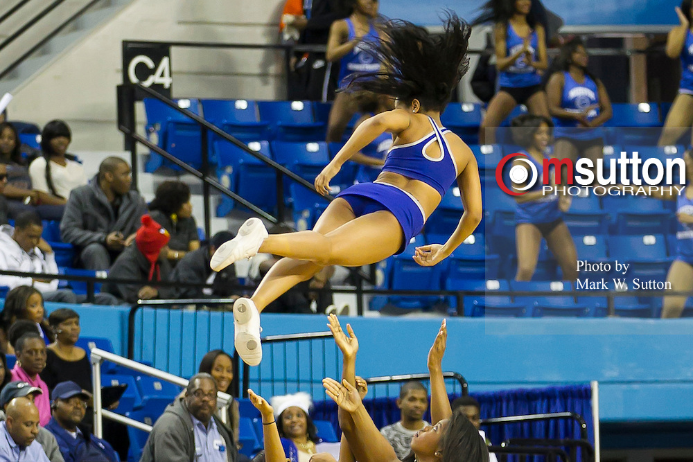 "Hampton's Blue Thunder Cheer Squad perform during the Hampton - Norfolk State ""Battle of the Bay"" NCAA basketball game played at the Hampton Convocation Center in Hampton, Virginia.  Hampton beat NSU 83-42.  February 18, 2013  (Photo by Mark W. Sutton)"