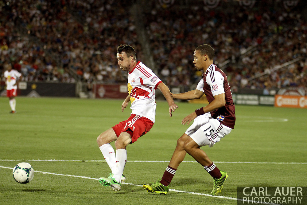 July 4th, 2013 - New York Red Bulls midfielder Eric Alexander (12) and Colorado Rapids defender Chris Klute (15) try to gain control of the ball in the second half of action in the Major League Soccer match between New York Red Bulls and the Colorado Rapids at Dick's Sporting Goods Park in Commerce City, CO