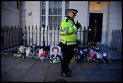 Police outside Baroness Thatcher's house after the death of Baroness Thatcher, outside her house in Chester Square, London, UK,Monday 8 April, 2013. Photo By Andrew Parsons / i-lmages.