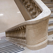 March 14, 2018 - New York, NY : The century-old Equitable Building, whose construction atop an entire city block at 120 Broadway in Lower Manhattan inspired the establishment of zoning regulations, has been undergoing a series of changes including the recent creation of a public hearing room for the Department of City Planning. Further renovation by the building's owner, Silverstein Properties, to be carried out by the architecture firm Beyer Blinder Belle and the landscape architecture firm MPFP, are also underway. Here, a staircase leads down to the lower concourse from the lobby.  CREDIT: Karsten Moran for The New York Times
