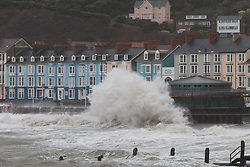 © Licensed to London News Pictures. 29/11/2015, Aberystwyth, Wales,  Huge waves smash into Aberystwyth as a low pressure system brings gale force winds ahead of the forecast Storm Clodagh. Photo credit: Jon Freeman/LNP