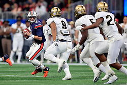 Auburn Tigers quarterback Jarrett Stidham (8) rolls out on a pass play during the 2018 Chick-fil-A Peach Bowl NCAA football game against the UCF Knights on Monday, January 1, 2018 in Atlanta. (Paul Abell / Abell Images for the Chick-fil-A Peach Bowl)