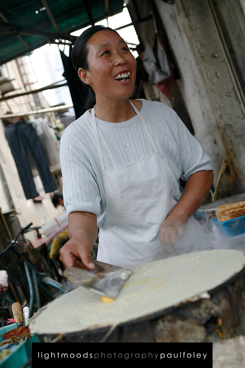 """Fast Food in Old Shanghai, China.<br /> Street food in Shanghai includes scallion pancakes and eggs and chive """"burrito"""""""