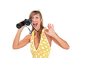Excited and happy young woman with binoculars