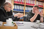 SELK Bishop Hans-Jörg Voigt chats with the Rev. James Krikava, OIM regional director for Eurasia, during a planning meeting at the SELK headquarters on Thursday, Nov. 12, 2015, in Hannover, Germany. LCMS Communications/Erik M. Lunsford