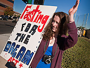 "07 DECEMBER 2010 - PHOENIX, AZ:  JULIE CAMERON from Chandler, AZ, pickets the offices of US Sen. John McCain in Phoenix Tuesday. Dolores Huerta, who started working in the civil rights movement in the 1960's, threw her support behind students fasting on behalf of the DREAM Act in front of Sen. John McCain's office Tuesday. The student picked McCain's office because he used to support the DREAM Act. They hope that the US Senate will pass the DREAM Act during its ""lame duck"" session. The Senate debated and defeated similar legislation just before the November general election.   PHOTO BY JACK KURTZ"