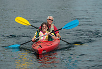 Colleen and Bill Cass paddling off Weirs Beach on Lake Winnipesaukee.    Karen Bobotas/for the Laconia Daily Sun