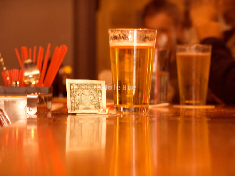 dollar bill tip on a bar slightly blurred