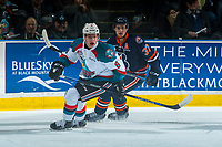 KELOWNA, CANADA - MARCH 24: Joe Gatenby #37 of the Kamloops Blazers back checks Jack Cowell #8 of the Kelowna Rockets on March 24, 2017 at Prospera Place in Kelowna, British Columbia, Canada.  (Photo by Marissa Baecker/Shoot the Breeze)  *** Local Caption ***