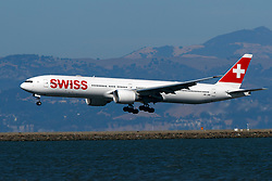 Boeing 777-3DE(ER) (HB-JNB) operated by Swiss landing at San Francisco International Airport (KSFO), San Francisco, California, United States of America