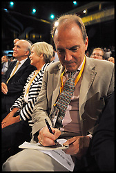 Simon Hughes Deputy Leader of the Lib Dems writes a cheque out to donate to the party before the Deputy Prime Minister Nick Clegg delivers his keynote speech at the end of the Liberal Democrats Conference in Brighton, Wednesday September 26, 2012 Photo Andrew Parsons / i-Images..
