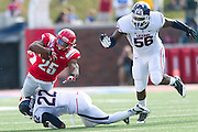 DALLAS, TX - NOVEMBER 16: K.C. Nlemchi #25 of the SMU Mustangs is tackled by Andrew Adams #22 of the Connecticut Huskies on November 16, 2013 at Gerald J. Ford Stadium in Dallas, Texas.  (Photo by Cooper Neill/Getty Images) *** Local Caption *** K.C. Nlemchi; Andrew Adams