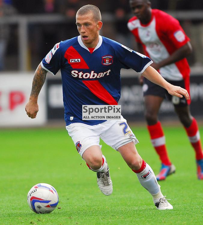 Joe Garner (Carlisle United, blue). .Carlisle v Crawley, Npower League One, 29th September 2012..(c)  Alex Todd | StockPix.eu
