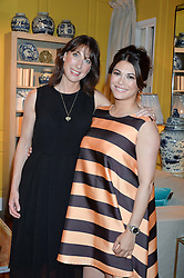 Left to right, SAMANTHA CAMERON and LOHRALEE ASTOR at a party to celebrate the publication of 'Feeding The Future' by Lohralee Astor and Tali Shine held at OKA, 155-167 Fulham Road, London on 8th June 2016.