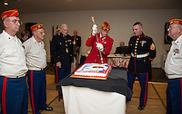 Commandant Bob Patenaude cuts the Marine Corps 241st birthday cake in tradition for youngest serving oldest the first slice at Pheasant Ridge Country Club on Saturday evening.  (l-r) Harold Chamberlin, Pete Romano, oldest marine present Harold Sheffield, Bob Patenaude, youngest marine present Dennis Dannenfelser and David French.  (Karen Bobotas/for the Laconia Daily Sun)
