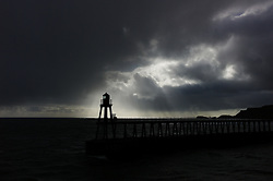 (C) Licensed to London News Pictures. 23/04/2016<br /> Whitby, UK<br /> <br /> Stormy clouds mix with early morning sunshine over the North Yorkshire coastal town of Whitby. <br /> <br /> Photo Credit: Ian Forsyth/LNP