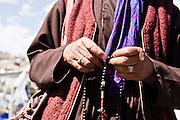 Worshiper with prayer beads.