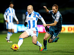 Aaron Mooy of Huddersfield Town goes past Shaun MacDonald of Wigan Athletic - Mandatory by-line: Robbie Stephenson/JMP - 28/11/2016 - FOOTBALL - The John Smith's Stadium - Huddersfield, England - Huddersfield Town v Wigan Athletic - Sky Bet Championship