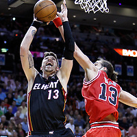 06 March 2010: Chicago Bulls center Joakim Noah (13) blocks Miami Heat shooting guard Mike Miller (13) during the Chicago Bulls 87-86 victory over the Miami Heat at the AmericanAirlines Arena, Miami, Florida, USA.