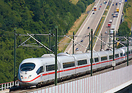 Europe, Germany, Rhineland-Palatinate, high-speed train ICE 3 on the high-speed line Frankfurt on the Main to Cologne parallel to the Autobahn A3 near Neustadt Wied, Hallerbachtal bridge.....Europa, Deutschland, Rheinland-Pfalz, ICE3 auf der Hochgeschwindigkeitsstrecke Frankfurt am Main  nach Koeln parallel zur Autobahn A3 bei Neustadt Wied, Hallerbachtalbruecke...