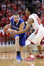 20 January 2017:  Matt Van Scyoc defended by Madison Williams(25) during an NCAA Missouri Valley Conference mens basketball game Where the Purple Aces of Evansville lost to the Illinois State Redbirds 75-73 in Redbird Arena, Normal IL