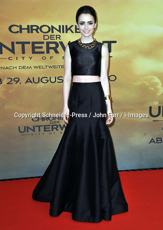 Lily Collins arrives for the 'The Mortal Instruments: City of Bones' Germany premiere at Sony Centre on Tuesday August 20, 2013 in Berlin, Germany. Photo by Schneider-Press / John Farr / i-Images. <br /> UK &amp; USA ONLY