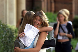 A - Level results at Chelmsford County High School for Girls. Lorraine Molyneux 18 (facing the camera), 3A's and 1B and a place at dental school, Julie Martindall 18, 4A's and 1C and a place a Oxford, August 17, 2000. Photo by Andrew Parsons/i-Images..