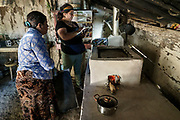 Gloribel, a researcher working with the Colorado State University Honduras Cookstove team, inspects one of the clean cookstoves that is part of the epidemiologic intervention study in Honduras. During this initial study, a partnership between CSU and Trees, Water & People (TWP) was formed. TWP has been working with communities and local NGOs to develop and distribute culturally acceptable cookstoves in Central America for decades and this partnership continues to be one of the most important features of our cookstove research.
