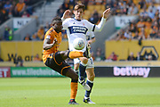 Middlesbrough midfielder Marten de Roon (14) tackles Wolverhampton Wanderers striker Bright Enobakhare (26) 0-0 during the EFL Sky Bet Championship match between Wolverhampton Wanderers and Middlesbrough at Molineux, Wolverhampton, England on 5 August 2017. Photo by Alan Franklin.