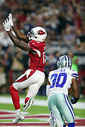 Arizona Cardinals running back Andre Ellington (38) leaps and catches a 25 yard touchdown pass for a 7-0 first quarter Cardinals lead while covered by Dallas Cowboys cornerback Anthony Brown (30) during the 2017 NFL week 3 regular season football game against the against the Dallas Cowboys, Monday, Sept. 25, 2017 in Glendale, Ariz. The Cowboys won the game 28-17. (©Paul Anthony Spinelli)