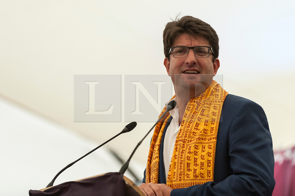 © Licensed to London News Pictures. 05/09/2015. Watford, UK. Lord Feldman of Elstree, chairman of the Conservative Party gives a speech as Zac Goldsmith, MP for Richmond, and other VIPs visit the biggest Janmashtami festival outside of India at the Bhaktivedanta Manor Hare Krishna Temple in Watford, Hertfordshire.  The event celebrates the birth of Lord Krishna and the festival  includes music, dance, food, dramas and more. Photo credit : Stephen Chung/LNP