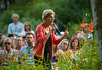 """Senator Elizabeth Warren speaks to the crowd gathered for a """"House Party"""" at the home of Edie and Paul DesMarais in Wolfeboro on Wednesday evening.  (Karen Bobotas/for the Laconia Daily Sun)"""