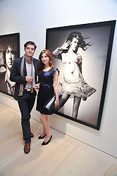 Actress EMMA HAMILTON and TOM BURKE at an exhibition of photographic portraits by Bryan Adams entitled 'Hear The World' at The Saatchi Gallery, King's Road, London on 21st July 2009.