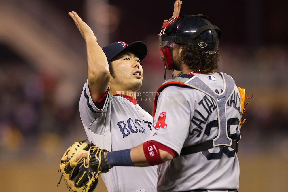 MINNEAPOLIS, MN - MAY 17: Koji Uehara #19 of the Boston Red Sox celebrates with Jarrod Saltamacchia #39 against the Minnesota Twins on May 17, 2013 at Target Field in Minneapolis, Minnesota. The Red Sox defeated the Twins 3-2. (Photo by Brace Hemmelgarn) *** Local Caption *** Koji Uehara;Jarrod Saltalamacchia