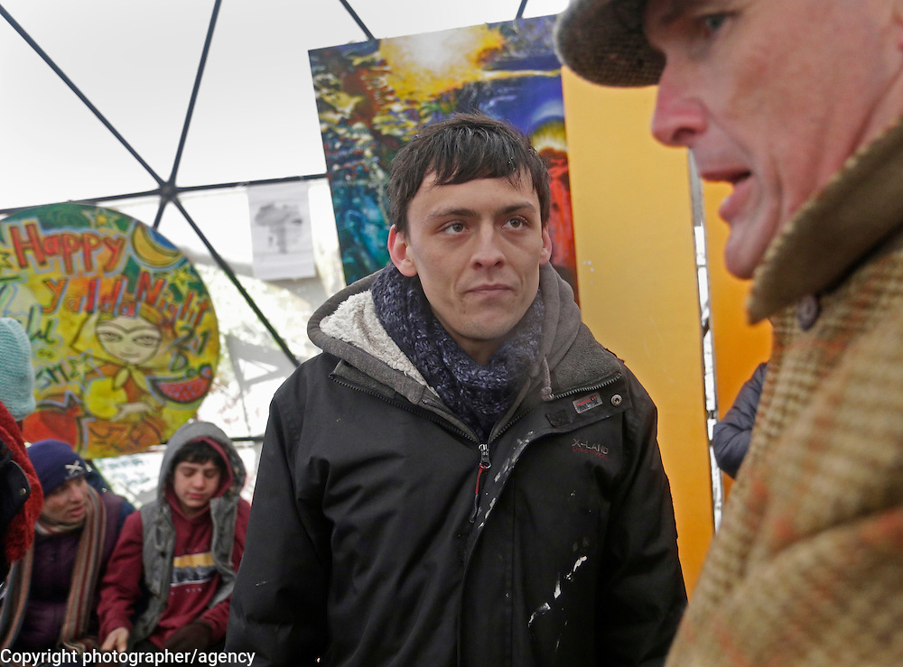 Joe Robertson (L) of the Good Chance Theatre company speaks withy writeer AA Gill in the makeshift theatre space he has created in the Jungle refugee camp, Calais, France, 22 January 2016